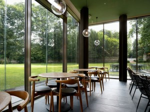 Chairs and tables by the glass walls of the Garden Cafe