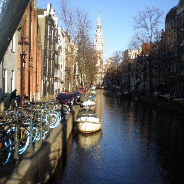 Boats, bicycles and buildings by the canal in Amsterdam