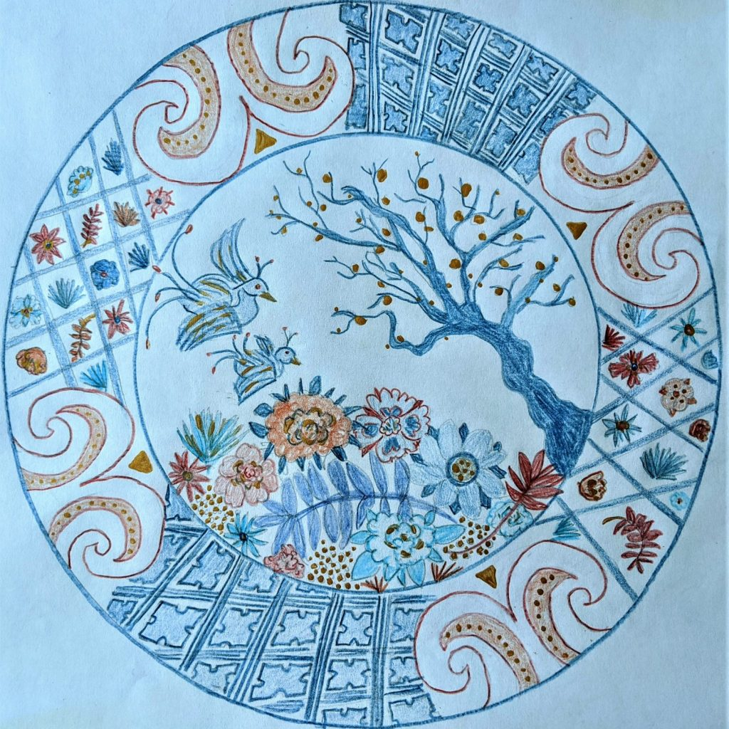 Blue, red and white Imari style plate with birds, tree and flower design inspired by the Imari collection in the Holburne Museum